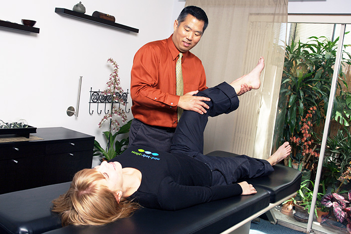 Chiropractice care with Dr. Wilson Park diagnostic leg manipulation